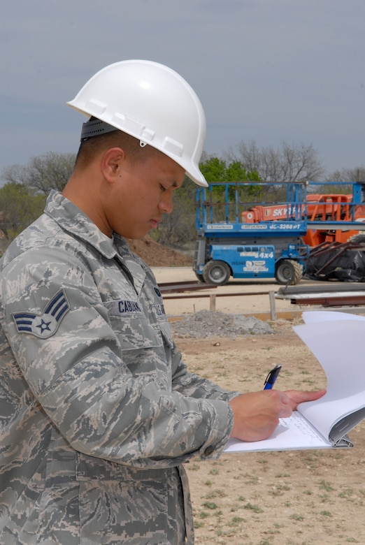 GOODFELLOW AIR FORCE BASE, Texas--Senior Airmen Angelo Mykael Cabuang, 17th Contracting Squadron contract specialist, takes notes while inspecting the progress on a construction site Apr 2. The inspection ensures the contractors are making progress, doing the work outlined in the contract and follow safety procedures. (U.S. Air Force photo/ Joseph Mather)