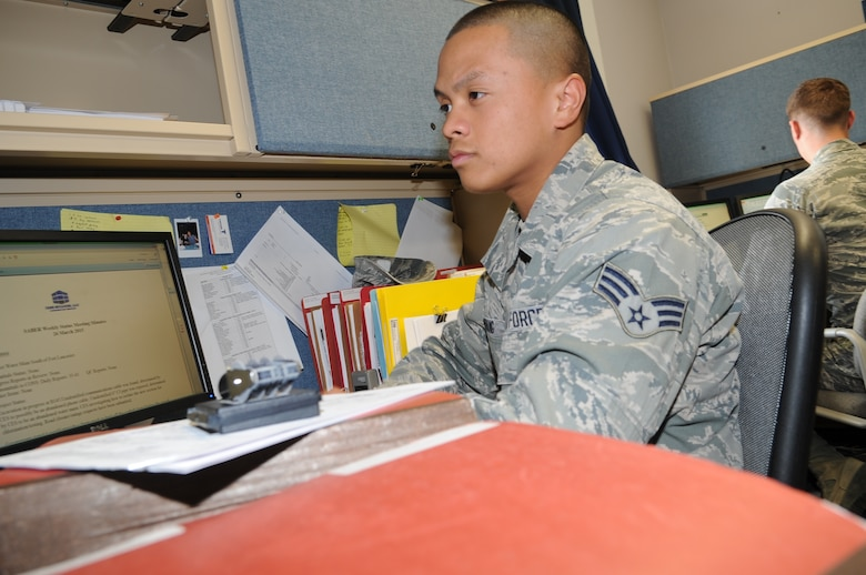 GOODFELLOW AIR FORCE BASE, Texas--Senior Airmen Angelo Mykael Cabuang, 17th Contracting Squadron contract specialist, works on the Simplified Acquisition of Base Engineering Requirement team's weekly status minutes Apr. 1.  Each week the SABER team meets to discuss the progress of each contract. (U.S. Air Force photo/ Joseph Mather)