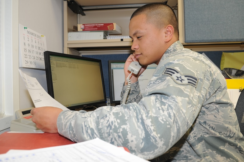 GOODFELLOW AIR FORCE BASE, Texas--Senior Airmen Angelo Mykael Cabuang, 17th Contracting Squadron contract specialist, discusses the details of an acquisition package with a customer Apr. 1. He ensures all documentation in the contract is correct with the customer before it proceeds to the contracting officer. (U.S. Air Force photo/ Joseph Mather)