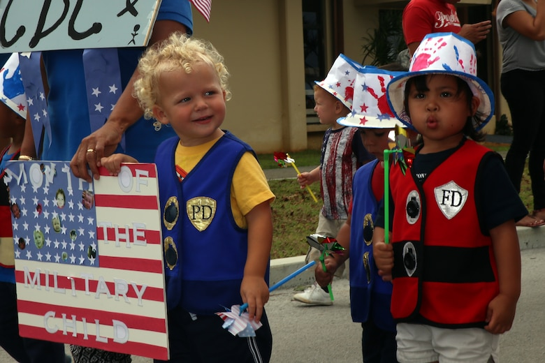 Andersen Child Development Center children participate in a parade April 10, 2015, at Andersen Air Force Base, Guam, to celebrate the Month of the Military Child. April was designated as the Month of the Military Child in 1986 to recognize sacrifices and contributions of children in the armed forces community. (U.S. Air Force photo by Staff Sgt. Melissa B. White/Released)