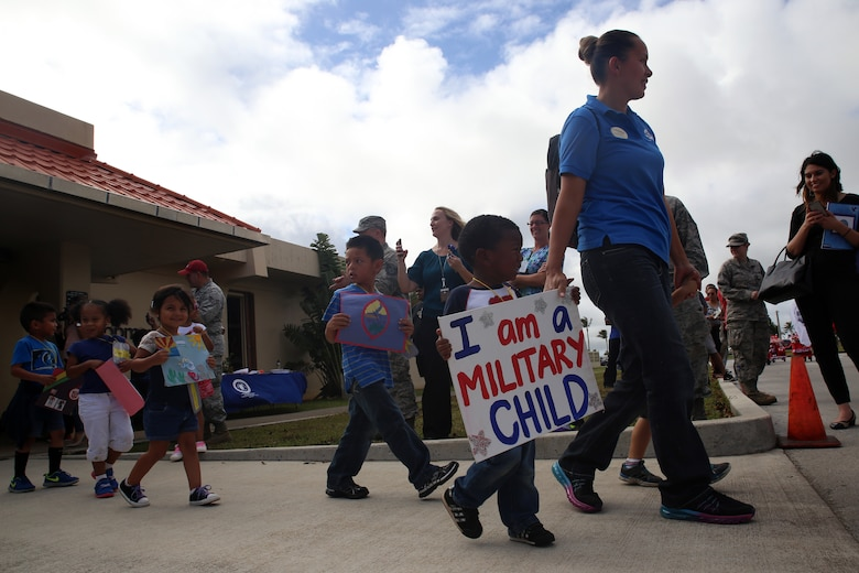 Andersen Child Development Center children and staff participate in a parade April 10, 2015, at Andersen Air Force Base, Guam, to celebrate the Month of the Military Child. April was designated as the Month of the Military Child in 1986 to recognize sacrifices and contributions of children in the armed forces community. (U.S. Air Force photo by Staff Sgt. Melissa B. White/Released)