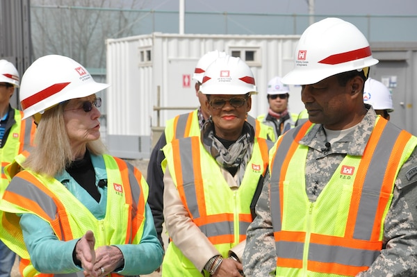 Lt. Gen. Thomas P. Bostick, commanding general of the U.S. Army Corps of Engineers (USACE) and 53rd Chief of Engineers, chats with Dr. Judith Allen, Department of Defense Education Activity Korea District superintendent (far left) about the millennial school construction project at Osan Air Base April 8, 2015. The school will be the first one in Korea with a 21st Century design.