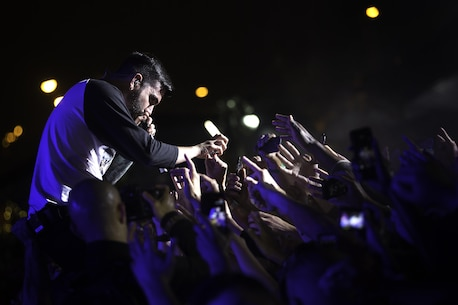 A Day to Remember frontman Jeremy McKinnon takes a GoPro camera from a fan and films the sea of hands reaching for him and eventually himself during the band's performance at Foster Fest 2015 April 11 on Camp Foster Okinawa, Japan. Foster Fest is an annual festival held on the camp bringing service members and Okinawa residents together through food, games and live entertainment. (U.S. Marine Corps photo by Sgt. Matthew Callahan/Released)