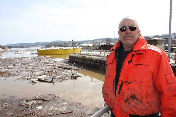 Lockmaster Paul Meininger stood against a backdrop of mud, ice and debris scattered across Monongahela River Locks and Dam 4 at Charleroi, March 7.