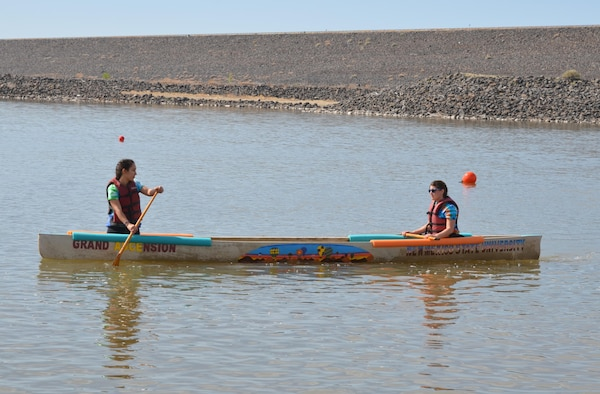 COCHITI LAKE, N.M. -- NMSU team members practice maneuvering their concrete canoe, April 11, 2015. NMSU placed first at the 44th annual American Society of Civil Engineers Rocky Mountain Regional Conference.