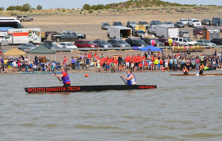 COCHITI LAKE, N.M. -- The South Dakota School of Mining and Technology team races their concrete canoe, April 11, 2015. The South Dakota school placed second at the conference.