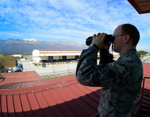 Senior Airman Aaron Antwine, a 31st Operations Support Squadron weather forecaster, checks visibility, April 8, 2015, at Aviano Air Base, Italy. Aviano's weather forecasters provide staff support to 31st Fighter Wing pilots, commanders and decision makers for 24/7 base resource protection along with airfield and mission services. (U.S. Air Force photo/Senior Airman Areca T. Wilson)