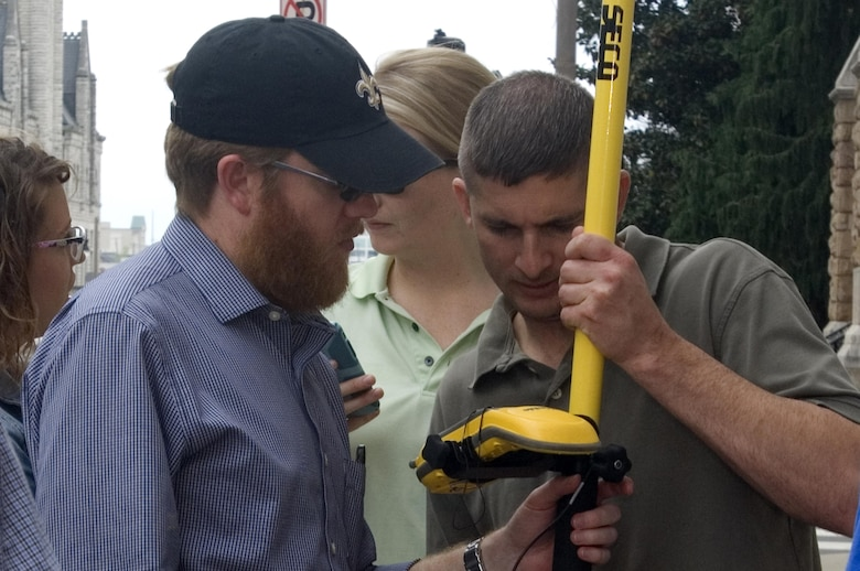 John Price (Left), regulatory specialist with the U.S. Army Corps of Engineers Nashville District Eastern Regulatory Field Office, and David Dame, navigation specialist in the Nashville District Navigation Branch, use a handheld GPS unit to collect data on the streets of Nashville, Tenn., April 9, 2015.  The U.S. Army Corps of Engineers Nashville District is working to use geospatial information systems to improve its processes.