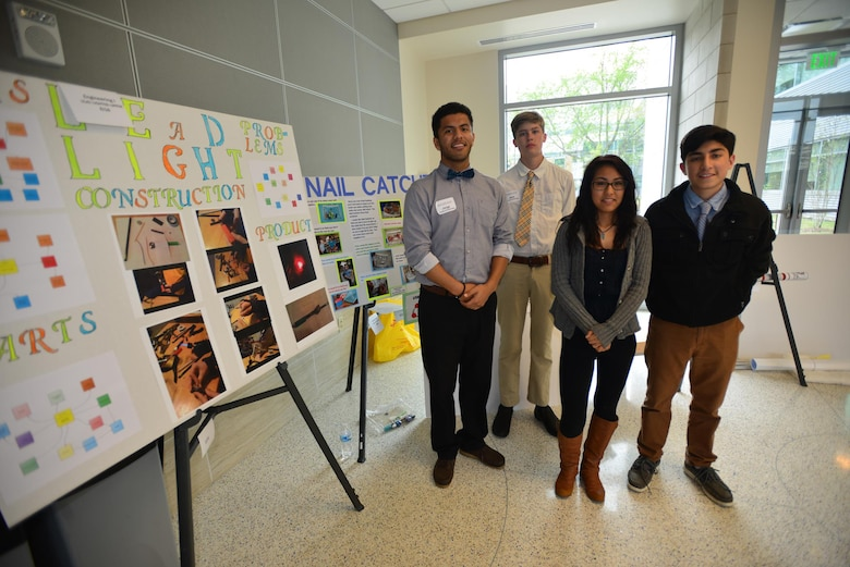 A team of high scholl students from Stratford High School (left to right)Jorge Carriedo, Jack Utley Mia Campbell–Smith,  and Christian Molnia deliver a brief presentation of their STEM project during a Science, Technology, Engineering and Mathematics Science Expo presented by the Middle Tennessee STEM Innovation Hub at the Middle Tennessee State University in Murfreesboro on April 9.