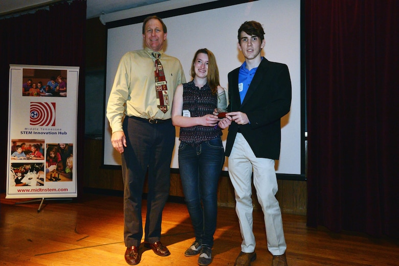 NASHVILLE, Tenn. (April 14, 2015) –Jimmy Waddle, chief of Engineering and Construction from the U.S. Army Corps of Engineers presents an award to Dylan Upchurch and Ester Soper, a two-student team from the Central Magnet High school in Murfreesboro for their Alternative Cooling System STEM project on April 9, 2015.  A group of technical experts from the U.S. Army Corps of Engineers Nashville District attended a Science, Technology, Engineering and Mathematics Science Expo as judges and staffed an exhibit sponsored by the Middle Tennessee STEM Innovation Hub at the Middle Tennessee State University in Murfreesboro.