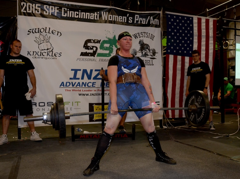 Staff Sgt. April Spilde, U.S. Air Force Honor Guard formal training instructor, deadlifts 340 pounds during the 2015 Cincinnati Women's Professional and Amateur Powerlifting Meet in Cincinnati, Ohio, April 11, 2015. Spilde is an award-winning amateur powerlifter and has been lifting for two years. (Courtesy photo/ Peter Spilde)