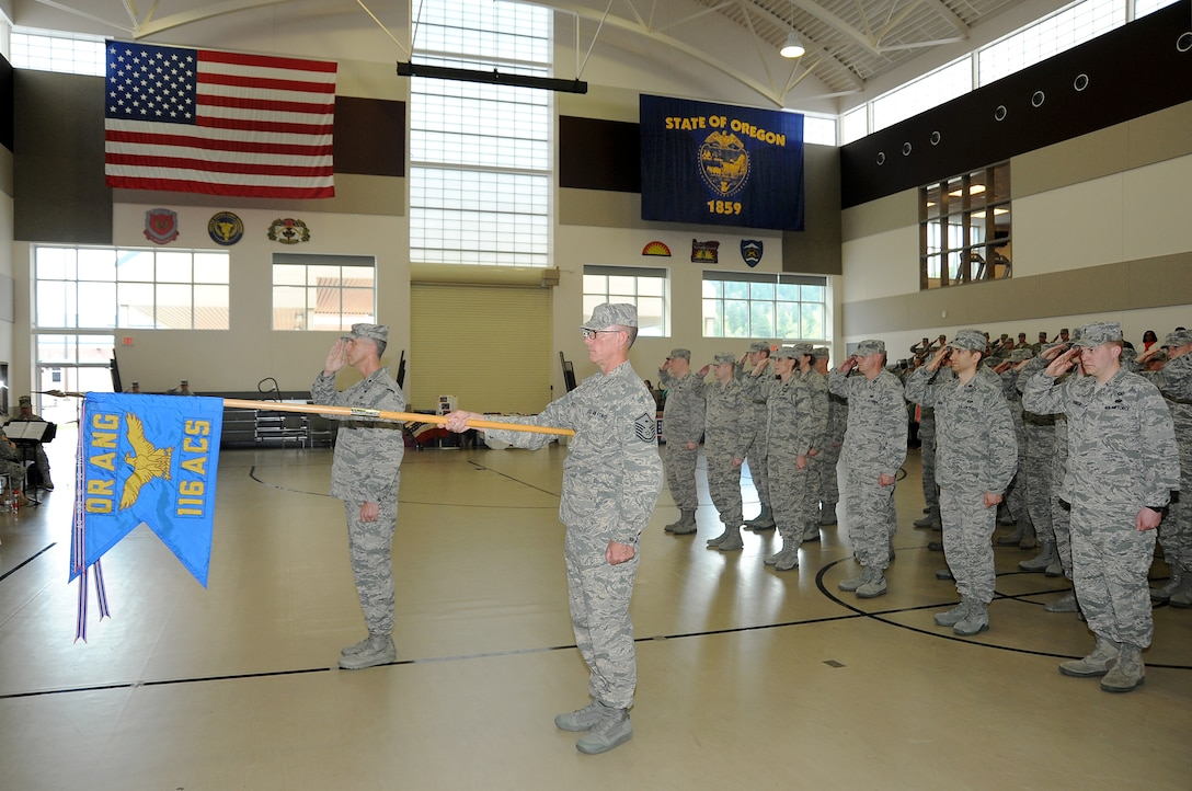 Members of the 116th Air Control Squadron, Oregon Air National Guard, are honored during a mobilization ceremony held at Camp Withycombe, in Clackamas, Ore., April 11, 2015. The 116th ACS, is tasked with a tactical control mission and reporting center, and is part of the Oregon Air National Guard Combat Operations Group. (U.S. Air National Guard Photo by Tech. Sgt. Emily Thompson, 142nd Fighter Wing Public Affairs/Released)