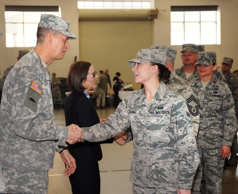 Oregon National Guard Airman 1st Class Lindsie N. Gallardo, assigned to the 116th Air Control Squadron (ACS), right, is greeted by Maj. Gen. Daniel R. Hokanson, The Adjutant General for Oregon, left, as Airmen from the unit conclude their formal mobilization ceremony at Camp Withycombe, Ore., April 11, 2015.  The 116th ACS, is based at Camp Rilea, Warrenton, Ore., and will be deployed for six months in support of the Overseas Contingency Operations.  (U.S. Air National Guard Photo by Tech. Sgt. Emily Thompson, 142nd Fighter Wing Public Affairs/Released)