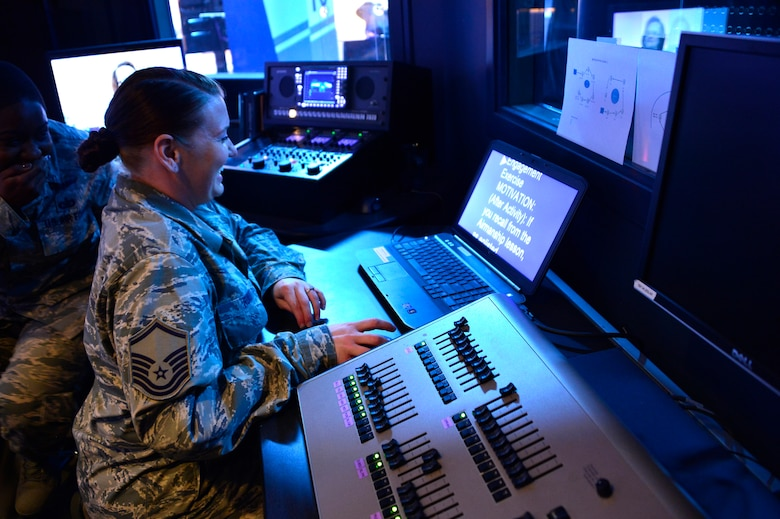 MCGHEE TYSON AIR NATIONAL GUARD BASE, Tenn. - Master Sgt. Elizabeth Ruiz, satellite EPME superintendent for the Paul H. Lankford EPME Center, and Staff Sgt.  Chalanda Roberts, broadcast technician, manage the broadcast control room for TEC TV during a satellite EPME practice broadcast here April 14, 2015, during the on-camera instructors' course.  (U.S. Air National Guard photo by Master Sgt. Mike R. Smith/Released)