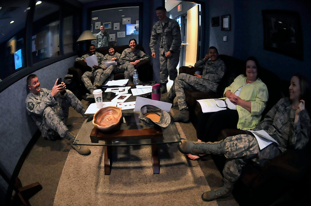 MCGHEE TYSON AIR NATIONAL GUARD BASE, Tenn. - Enlisted professional military education instructors from the Paul H. Lankford EPME Center here laugh in the TEC TV green room April 14, 2015, while watching their peers practice satellite EPME instruction on camera.   (U.S. Air National Guard photo by Master Sgt. Mike R. Smith/Released)