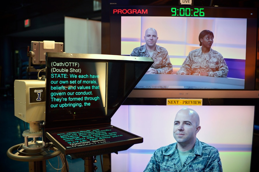 MCGHEE TYSON AIR NATIONAL GUARD BASE, Tenn.  -  Master Sgt. Jason Goodman and Master Sgt.  Jeela Matthews, EPME instructors for the Paul H. Lankford EPME Center, prepare to anchor satellite broadcasts for class critique in the television studio at the I.G. Brown Training and Education Center, April 14, 2015, during the on-camera instructors' course.  (U.S. Air National Guard photo by Master Sgt. Mike R. Smith/Released)