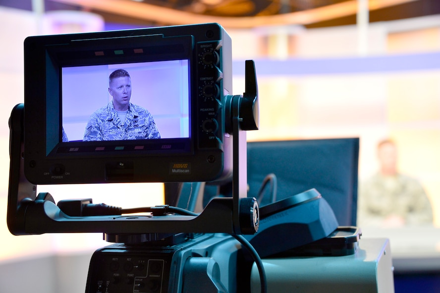 MCGHEE TYSON AIR NATIONAL GUARD BASE, Tenn. - Tech. Sgt. William Bryant, EPME instructor for the Paul H. Lankford EPME Center, reads the teleprompter from the television studio one broadcast desk here at the I.G. Brown Training and Education Center, April 14, 2015, during the on-camera instructors' course.  (U.S. Air National Guard photo by Master Sgt. Mike R. Smith/Released)