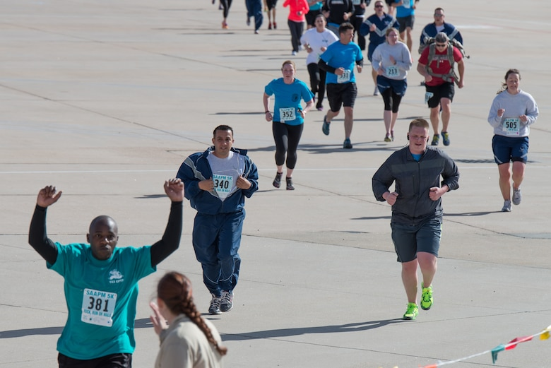 Military Soldiers and Airmen assigned to the Wyoming National Guard along with family members run, walk ,and march five kilometers April 12, 2015, at Cheyenne Air National Guard Base in Cheyenne, Wyo. The Guardsmen and families participated in the inaugural Sexual Assault Awareness and Prevention 5k ruck 5k run/walk which raised over $900 for local charities. (U.S. Air National Guard photo by Master Sgt. Charles Delano)