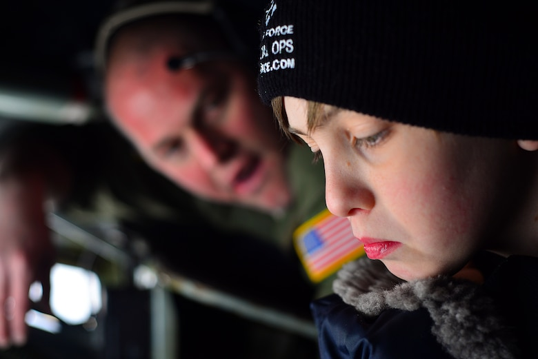 Ian Straight, a 12-year-old from Lancaster, Ohio, learns about a boom operator's job from Tech Sgt. Ryan Dunn during his day in the pilot for a day program March 19, 2015, at Rickenbacker Air National Guard Base, Ohio. The program treats a youth with chronic or life threatening illnesses to a day of military experiences. The 121st ARW has partnered with Nationwide Children's Hospital to provide this opportunity. (U.S. Air National Guard photo by Master Sgt. Ralph Branson/Released)