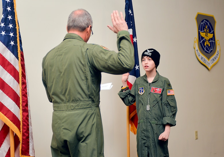U.S. Air Force Col. Jim Jones administers an oath of fun to Ian Straight, a 12-year-old taking part in the 121st Air Refueling Wing's pilot for a day program March 19, 2015, at Rickenbacker Air National Guard Base, Ohio. The program treats a youth with chronic or life threatening illnesses to a day of military experiences. The 121st ARW has partnered with Nationwide Children's Hospital to provide this opportunity. (U.S. Air National Guard photo by Master Sgt. Ralph Branson/Released)