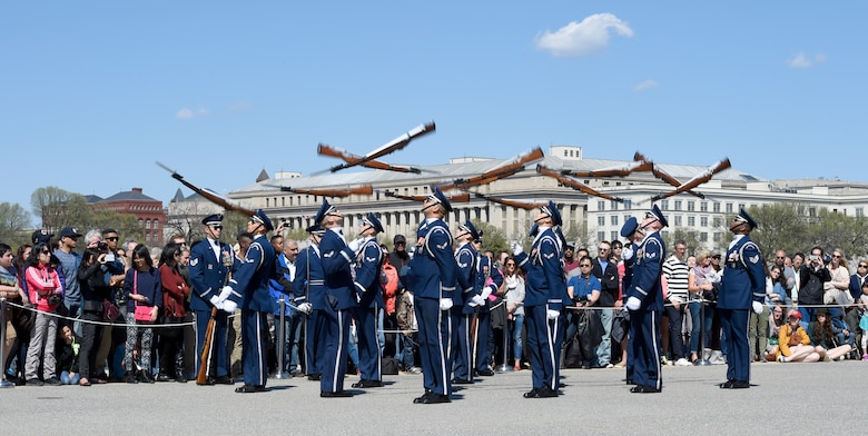 The United States Air Force Honor Guard hurls their rifles through the air during the Joint Service Drill Exhibition in Washington, D.C., April 11, 2015. The Old Guard, Army, Navy, Marines, Coast Guard and Naval Academy's drill team also performed during the event. (U.S. Air Force photo/Airman 1st Class Ryan J. Sonnier)