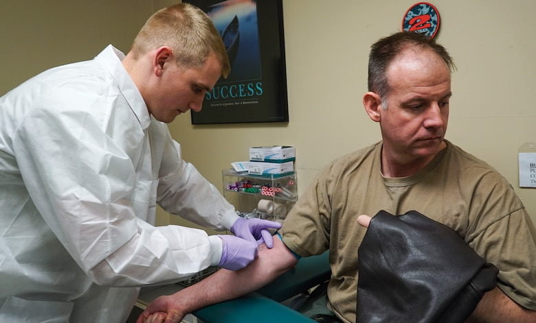 WRIGHT-PATTERSON AIR FORCE BASE, Ohio - Staff Sgt. Logan McKinney, a medical laboratory technician with the 445th Aerospace Medicine Squadron, draws blood from Lt. Col. Richard Klarich, 89th Airlift Squadron pilot. Other parts of the assessment involve optometry, lab testing, immunizations and general counseling. ((U.S. Air Force photo/Senior Airman Devin Long)