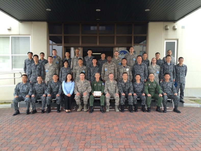 U.S. Air Force and Japan Air Self-Defense Force members pose for a picture outside the wing building during the noncommissioned officer exchange program at Komaki Air Base, Japan, March 27, 2015. Yokota's Airmen were able to tour the facilities, see day-to-day operations and work with our Japanese counterparts. (Courtesy photo)