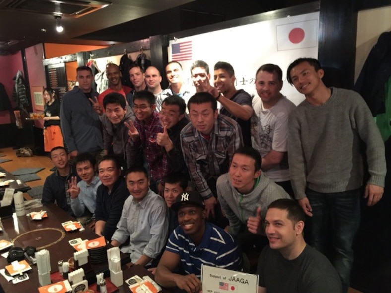 Yokota Airmen pose for a picture with Japan Air Self-Defense Force members at a restaurant during the noncommissioned officer exchange program at Komaki Air Base, Japan, March 23, 2015. Thirteen Airmen from Yokota stayed at Komaki Air Base for eight days and were able to experience the differences and similarities of U.S. and Japanese military life. (Courtesy photo)
