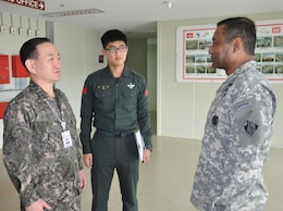 Lt. Gen. Thomas P. Bostick, commanding general of the U.S. Army Corps of Engineers (USACE) and 53rd Chief of Engineers, meets Brig. Gen. Kang, Chang-koo, Director General of Program Management, Ministry of Defense United States Forces Korea Relocation Office at the program management office outside U.S. Army Garrison Humphreys April 8, 2015.