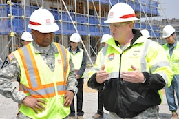 "Lt. Gen. Thomas P. Bostick, commanding general of the U.S. Army Corps of Engineers (USACE) and 53rd Chief of Engineers, discusses the U.S. Army Garrison Humphreys ""downtown"" construction project with Col. Bryan S. Green, district engineer and commander April 8, 2015."