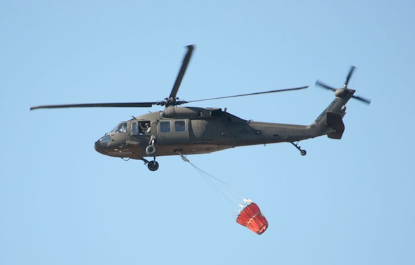 A North Dakota Army National Guard UH-60 Black Hawk helicopter departs from the Guard's Army Aviation Support Facility in Bismarck, N.D., April 13, 2015. It was one of two Guard helicopters en route to a mission supporting local response authorities fighting a wildfire in Burleigh County. U.S. Army National Guard photo by Laura Prokopyk