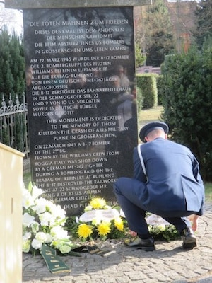 Col David Pedersen, air attaché to Germany, lays flowers at the Peace Memorial Monument in Großräschen, Germany, which honors the American crewmembers and German civilians killed in the crash of an American B-17.