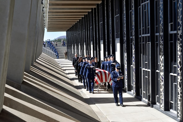 Rabbi (Maj.) Sarah Schechter, a Cadet Chapel Jewish chaplain, reads from the Torah while the honor guard escorts the casket containing the remains of Capt. Richard D. Chorlins, an Academy Class of '67 graduate, into the Cadet Chapel at the U.S. Air Force Academy, Colo., April 14, 2015. Chorlins was killed in Vietnam in January 1970. His remains were transferred here April 13, 2015, in a dignified arrival ceremony and he was laid to rest at the Academy Cemetery April 14, 2015. (U.S. Air Force photo/Liz Copan)