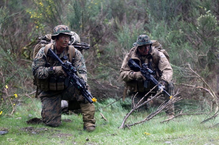 Marines with Company C, 1st Reconnaissance Battalion, provide security for their team during a simulated casualty evacuation aboard Joint Base Lewis-McChord, Wash, April 10, 2015. Marines with the company operated in remote locations of the wilderness and provided surveillance of the surrounding area to paint the commander a picture of the battlefield. During the patrol, the reconnaissance men navigated through several kilometers of thick brush and provided surveillance on numerous named areas of interest. The patrol was one of many exercises the company will complete as part of a combat readiness evaluation in preparation for an upcoming deployment. (U.S. Marine Corps photo by Sgt. Joseph Scanlan / released)
