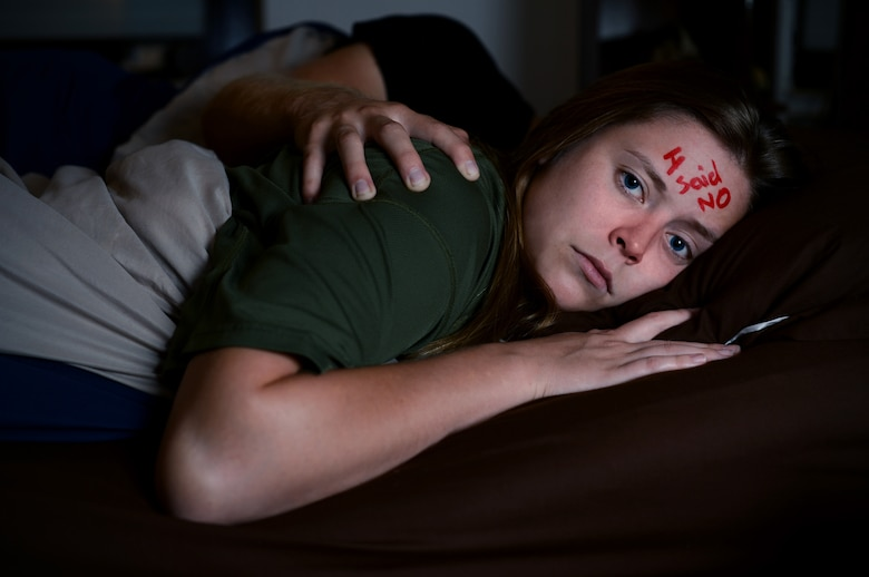 U.S. Air Force Airman 1st Class Kayleen Moss, a 52nd Medical Operations Squadron pediatrics technician, and her husband, Brandon, pose for an anti-sexual assault campaign image at Spangdahlem Air Base, Germany, Aug. 13, 2014. The Air Force Sexual Assault Prevention and Response program provides services to assist victims and survivors of sexual violence. SAPR has an ongoing campaign to encourage people to step up and step in to prevent sexual assault. Victims can reach a trained victim advocate 24/7 on the Whiteman Air Force Base SAPR confidential hotline at 660-687-7272.  (U.S. Air Force photo by Airman 1st Class Kyle Gese/Released)