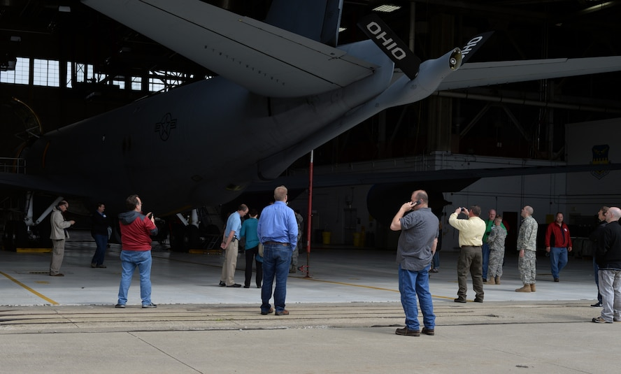 Ohio Employers tour a static display of a KC-135 Stratotanker during the Ohio National Guard Northwest Joint Employer Event April 9, 2015 at Rickenbacker Air National Guard Base, Ohio. The event was held for employers around Ohio to come and learn about the mission of the National Guard, to foster support and build a partnership. (U.S. Air National Guard photo by Airman Ashley Williams/Released)