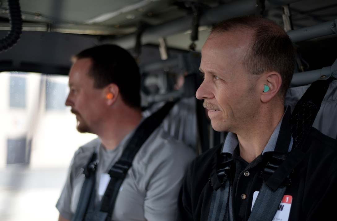 Police Lt. Andrew Painter, with the Columbus, Ohio Police Department, waits for departure on a UH-60L Black Hawk April 9, 2015 at Rickenbacker Air National Guard Base, Ohio. The flight was for the Ohio National Guard Northwest Joint Employer Event, held for employers around the state of Ohio, to help them understand the mission of the National Guard. (U.S. Air National Guard photo by Airman Ashley Williams/Released)