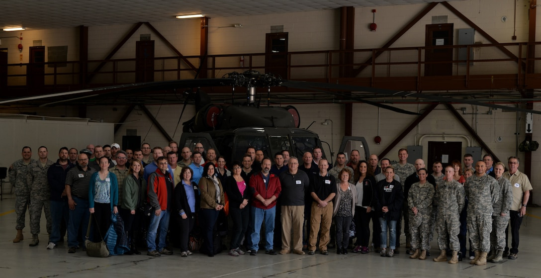 U.S. Service members pose with Ohio employers during the Ohio National Guard Northwest Joint Employer Event April 9, 2015 at Rickenbacker Air National Guard Base, Ohio. The event was held for employers around Ohio to come and learn about the mission of the National Guard, to foster support and build a partnership. (U.S. Air National Guard photo by Airman Ashley Williams/Released)