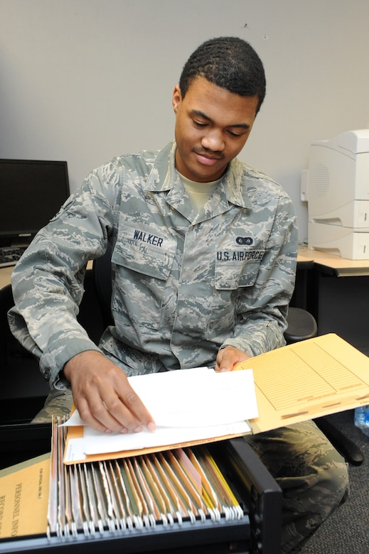 Airman 1st Class Jamal Walker, 319th Comptroller Squadron commander support staff member, reviews feedback notifications on Grand Forks Air Force Base, N.D., April 14, 2015. Walker was selected at the base's Warrior of the Week for the third week of April 2015. (U.S. Air Force photo by Staff Sgt. David Dobrydney/Released)