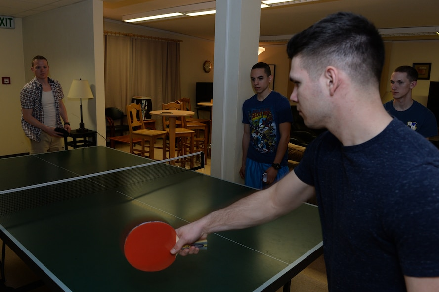 Two U.S. Air Force Airman play pingpong as others look on April 10, 2015, at the Coffee Mill on Spangdahlem Air Base, Germany. The chapel recently decided to expand the hours of operations to Tuesday-Wednesday from 6-10 p.m., Thursday from 7:30-10 p.m. and Friday-Saturday from 7-11 p.m. (U.S. Air Force photo by Senior Airman Dylan Nuckolls/Released)
