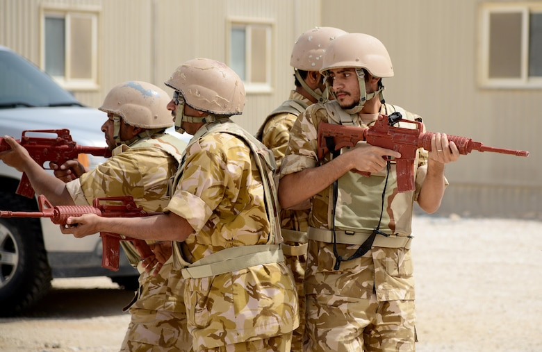 Members of the Qatar Emiri Air Force practice a diamond fire team movement during joint interoperability training April 14, 2015, at Al Udeid Air Base, Qatar. This type of movement can be used during patrols or moving through buildings. Airmen from the 379th ESFS shared techniques and procedures with members of the Qatar Emiri Air Force during this joint training. Training like this enhances the interoperability of both the U.S. and its host nation partners and helps improve bilateral relations by sharing techniques on how each country operates. (U.S. Air Force photo by Senior Airman Kia Atkins)