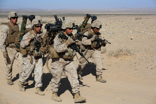 Marines with Anti-Armor Section, Weapons Company, Ground Combat Element Integrated Task Force, conduct a team movement during a Marine Corps Operational Test and Evaluation Activity assessment at Range 107, Marine Corps Air Ground Combat Center Twentynine Palms, California, April 11, 2015. From October 2014 to July 2015, the GCEITF will conduct individual and collective level skills training in designated ground combat arms occupational specialties in order to facilitate the standards-based assessment of the physical performance of Marines in a simulated operating environment performing specific ground combat arms tasks. (U.S. Marine Corps photo by Cpl. Paul S. Martinez/Released)