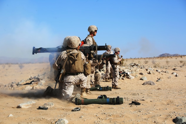 Marines with Anti-Armor Section, Weapons Company, Ground Combat Element Integrated Task Force, fire the MK153 shoulder-launched multipurpose assault weapon (SMAW) during a Marine Corps Operational Test and Evaluation Activity assessment at Range 107, Marine Corps Air Ground Combat Center Twentynine Palms, California, April 11, 2015. From October 2014 to July 2015, the GCEITF will conduct individual and collective level skills training in designated ground combat arms occupational specialties in order to facilitate the standards-based assessment of the physical performance of Marines in a simulated operating environment performing specific ground combat arms tasks. (U.S. Marine Corps photo by Cpl. Paul S. Martinez/Released)