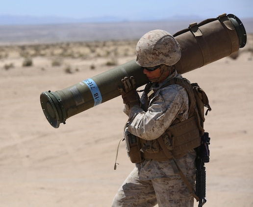 Sgt. Maya Marin C. Garnica, anti-tank missileman, Anti-Armor Section, Weapons Company, Ground Combat Element Integrated Task Force, carries a tube-launched, optically-tracked, wire-guided missile to the firing line during a Marine Corps Operational Test and Evaluation Activity assessment at Range 107, Marine Corps Air Ground Combat Center Twentynine Palms, California, April 12, 2015. From October 2014 to July 2015, the GCEITF will conduct individual and collective level skills training in designated ground combat arms occupational specialties in order to facilitate the standards-based assessment of the physical performance of Marines in a simulated operating environment performing specific ground combat arms tasks. (U.S. Marine Corps photo by Cpl. Paul S. Martinez/Released)