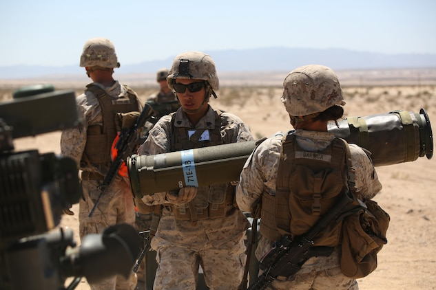 Sergeants Emma A. Bringas, left, and Maya Marin C. Garnica, both anti-tank missilemen with Anti-Armor Section, Weapons Company, Ground Combat Element Integrated Task Force, reload an M41A4 Saber missile launcher during a Marine Corps Operational Test and Evaluation Activity assessment at Range 107, Marine Corps Air Ground Combat Center Twentynine Palms, California, April 12, 2015. From October 2014 to July 2015, the GCEITF will conduct individual and collective level skills training in designated ground combat arms occupational specialties in order to facilitate the standards-based assessment of the physical performance of Marines in a simulated operating environment performing specific ground combat arms tasks. (U.S. Marine Corps photo by Cpl. Paul S. Martinez/Released)