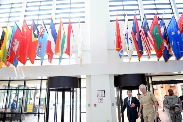 In this file photo, Defense Secretary Ash Carter speaks with Navy Adm. Samuel J. Locklear III at U.S. Pacific Command headquarters at Camp Smith, Hawaii April 12, 2015. Three days later, Locklear joined other Defense Department leaders on Capitol Hill for a hearing on maintaining the U.S. military's technological edge.