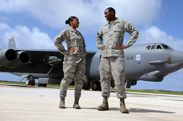 Airmen 1st Class Ashley, 20th Expeditionary Bomb Squadron combat crew communications apprentice, and Iseral McDowell, 36th Expeditionary Aircraft Maintenance Squadron hydraulic systems apprentice, stand in front of a B-52H Stratofortress at Andersen Air Force Base, Guam, April 7, 2015. The McDowells are deployed here with the B-52s from Barksdale AFB, La. (U.S. Air Force photo by Airman 1st Class Alexa Ann Henderson/Released)