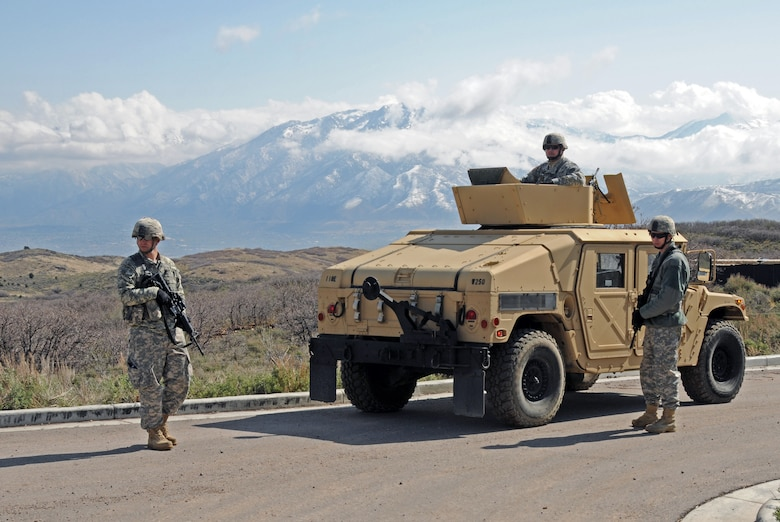 Members of the Army National Guard's 1457th Engineer Battalion participate in a training exercise conducted with explosive ordnance technicians from the Air National Guard's 151st Civil Engineering Squadron at the Improvised Explosive Device Training Lane at Camp Williams, Utah on April 9, 2015. The training scenario involved the removal of a simulated landmine, followed by a discussion with Moroccan State Partners. (Air National Guard photo by Staff Sgt. Annie Edwards/RELEASED)