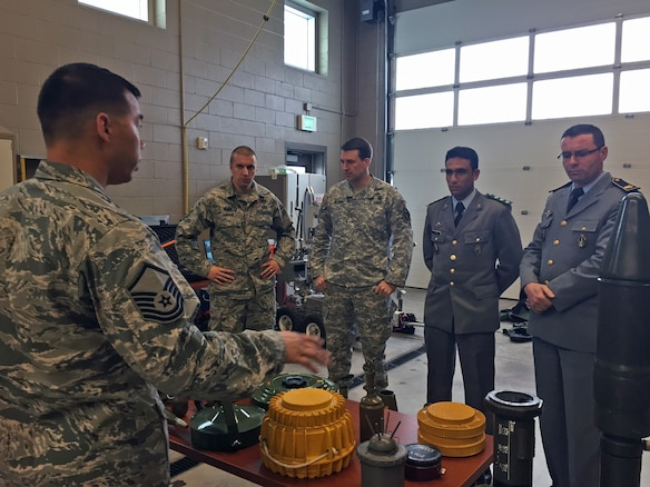 Master Sgt. Timothy Edwards gives a presentation about Utah Air Guard explosive ordnance disposal capabilities to members of the Moroccan military visiting the Roland R. Wright Air National Guard Base on April 7, 2015. The Moroccan delegates visited the state to work with Utah Guardsmen as part of the State Partnership Program. (Air National Guard photo by Capt. Jill Jimenez/RELEASED)