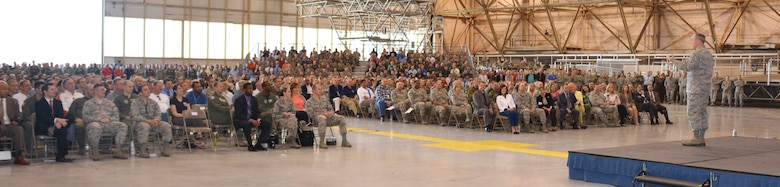 Air Force Chief of Staff Gen. Mark A. Welsh III addresses a standing-room-only crowd of uniformed and civilian Airmen at Tinker Air Force Base during an All-Call April 10 in Bldg. 230, Dock 2. The All-Call was just one of many events attended by General Welsh and his wife, Betty, as part of the couple's three-day tour of the base. (Air Force photo by Darren D. Heusel)